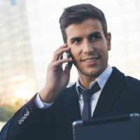 Portrait of a businessman using mobile phone